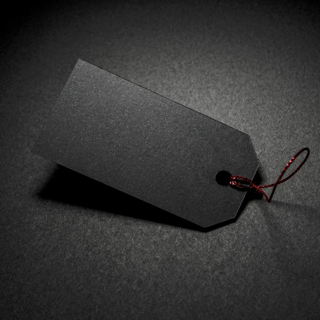 Mysterieuze prijskaartje donkere achtergrond Gratis Foto