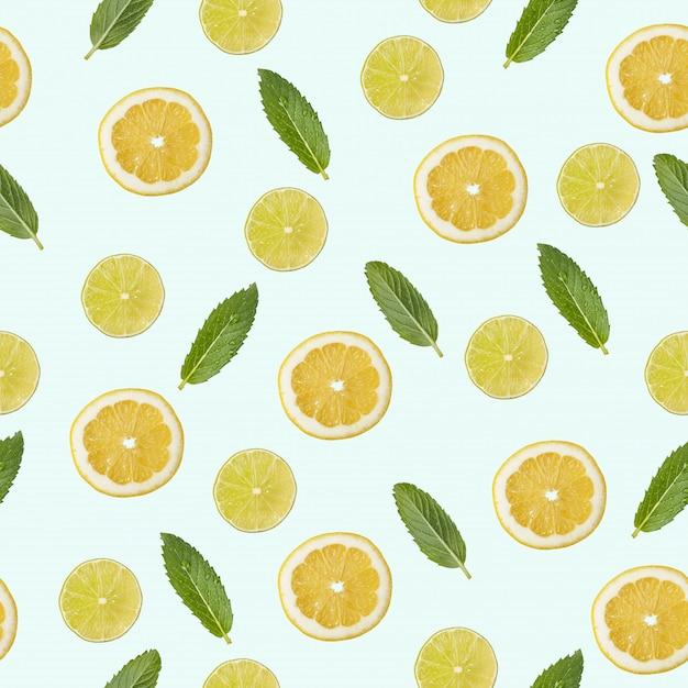 Naadloos patroon met een afbeelding van citroen, limoen en munt. Premium Foto