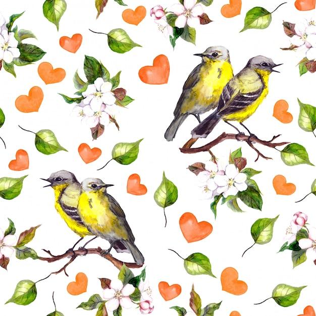 Naadloos patroon met twee vogels op bloementak, harten Premium Foto