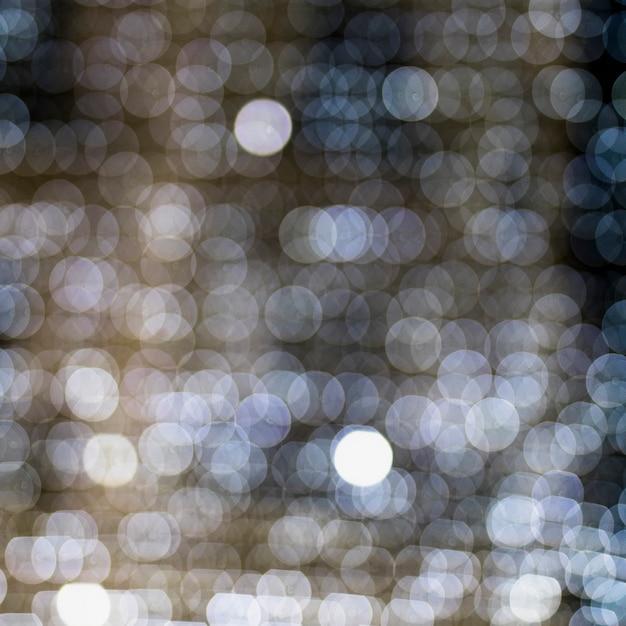 Naadloos patroon van witte gloeiende verlichte bokeh achtergrond Gratis Foto