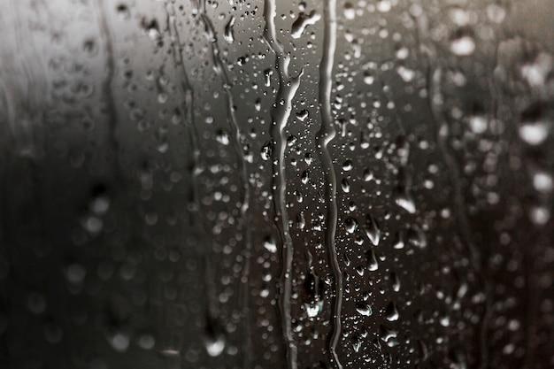 Nat beslagen glas met waterdruppels Gratis Foto