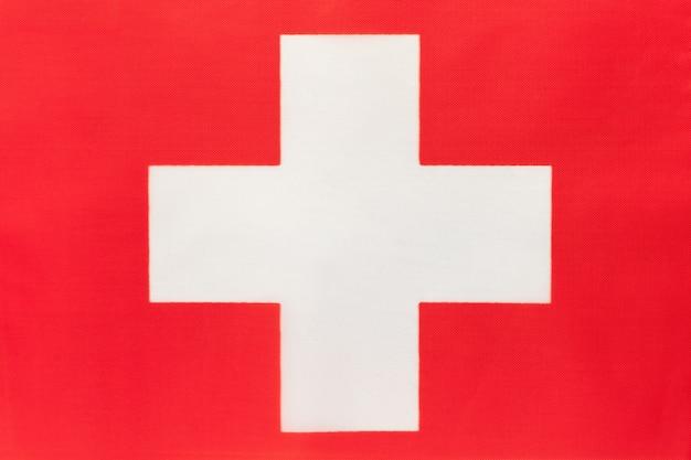 Nationale de stoffenvlag van zwitserland, textielachtergrond Premium Foto