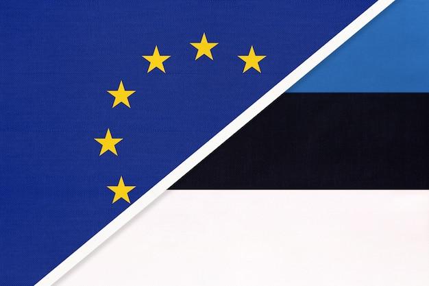 Nationale vlag van de europese unie of eu versus republiek estland van textiel. Premium Foto