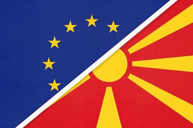 Nationale vlag van de europese unie of eu versus republiek macedonië van textiel. Premium Foto