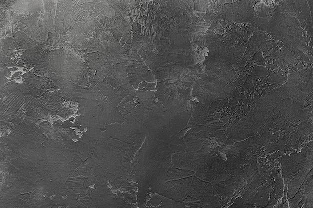 Natuurlijke gestructureerde abstracte achtergrond van decoratieve muur van donkergrijze kleur. Premium Foto