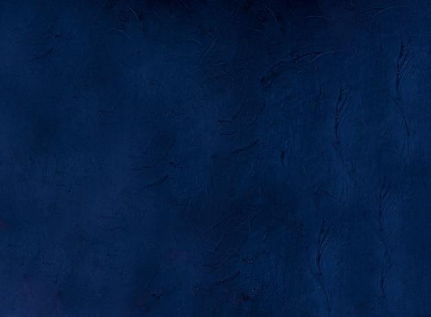 Navy abstract decoratief donkerblauw stucwerk muurfonds. gestructureerde achtergrond Premium Foto