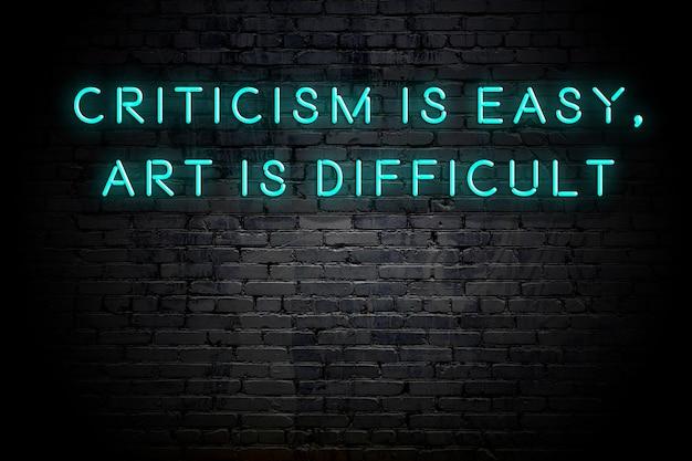 Neoninschrijving van positief wijs motiverend citaat tegen bakstenen muur Premium Foto