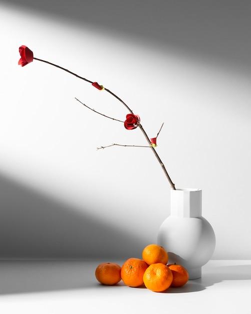 Nieuwjaar chinees 2021 stapel sinaasappelen en bloem Gratis Foto