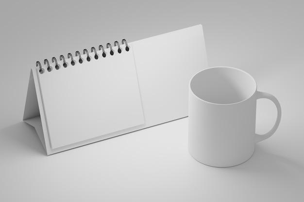 Office tabelsjabloon met witte staande spiraal kalender en lege koffiemok beker op wit Premium Foto