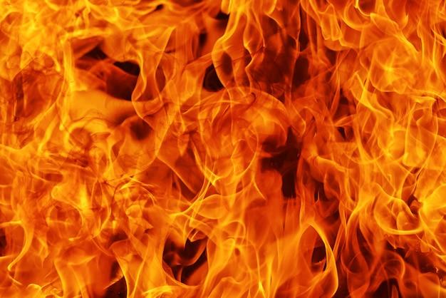 Ontsteken van vlam achtergrond en abstract, detail van vuur Premium Foto