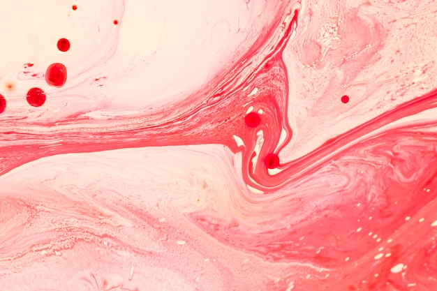 Onwerkelijk roze golven in olie Gratis Foto