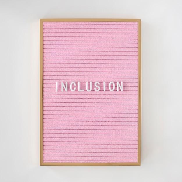 Opname woord geschreven op een roze canvas met frame Gratis Foto
