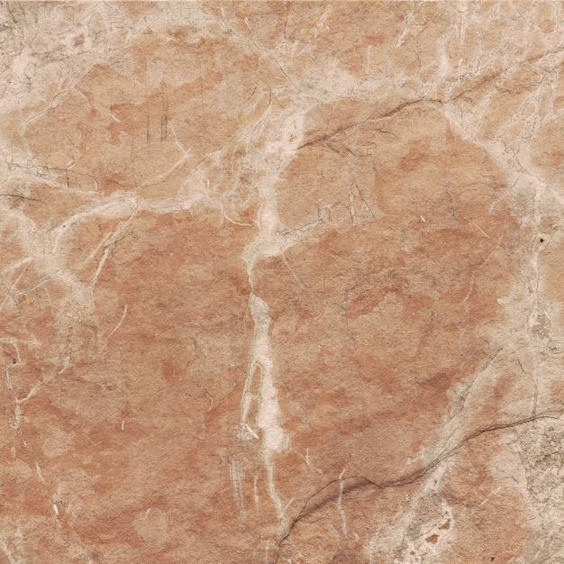 Oranje steen met aderen textuur Gratis Foto