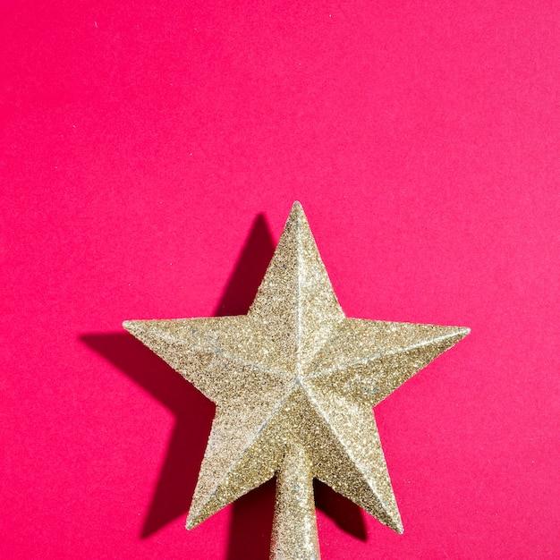 Ornament gouden ster met schaduw Gratis Foto
