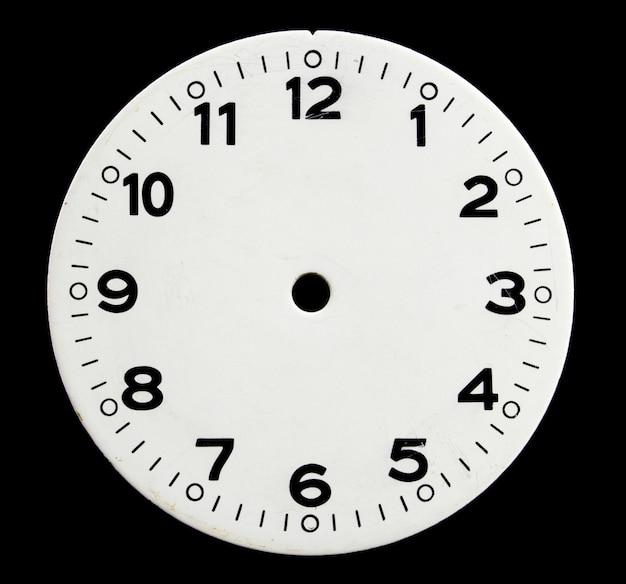 Oud gezicht van de klok op een zwarte Premium Foto