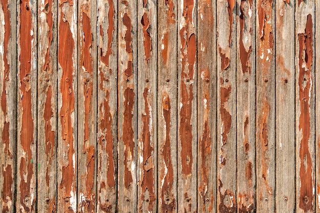 Oud rood houten plankpatroon op lijst met grunge en gepeld van oppervlakte. abstracte achtergrond. vintage en retro achtergrond. Premium Foto