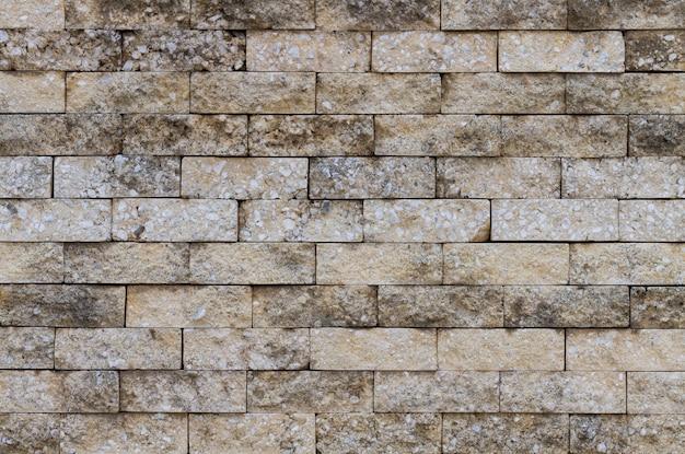 Oude bakstenen muur in stedelijke straten Gratis Foto