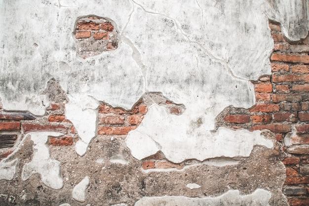 Oude bakstenen muur met cement textuur achtergrond. Premium Foto