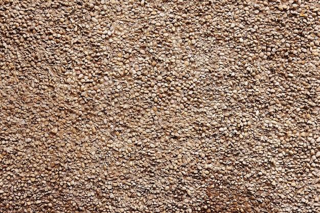 Oude beige van de steenmuur textuur als achtergrond Premium Foto