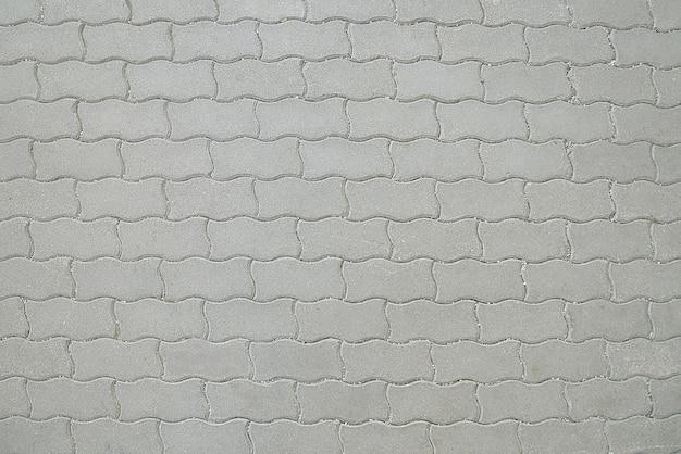 Oude de bestratingstextuur van het weg grijze mozaïek Premium Foto