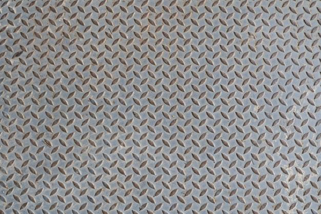 Oude de vloerplaat van het staalmetaal met de textuurachtergrond van het diamantpatroon Premium Foto