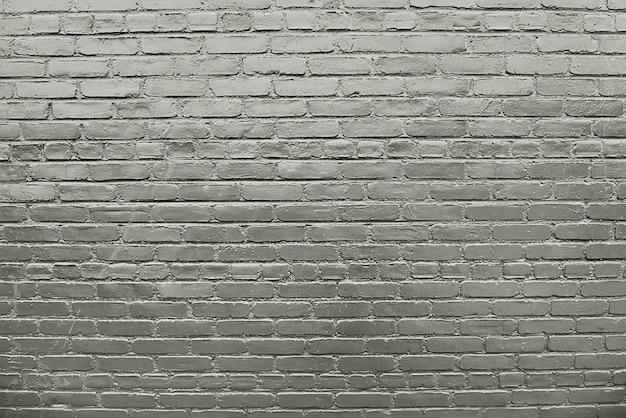 Oude grijze bakstenen muurtextuur als achtergrond Premium Foto