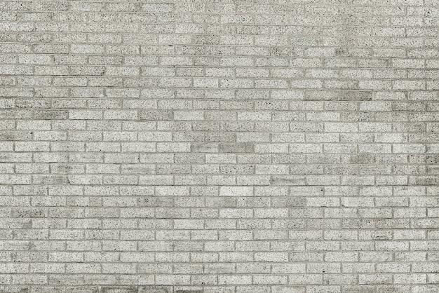 Oude grijze bakstenen muurtextuur Premium Foto