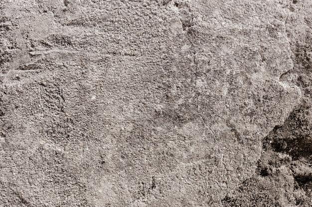 Oude grijze gebarsten muur Gratis Foto