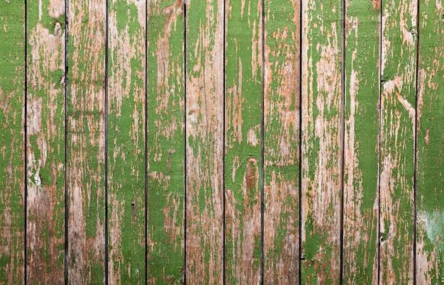 Oude houten achtergrond met groen mos Gratis Foto