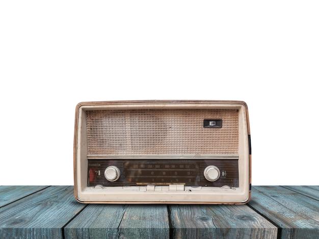 Oude retro radio op blauwe houten lijst aangaande wit Premium Foto