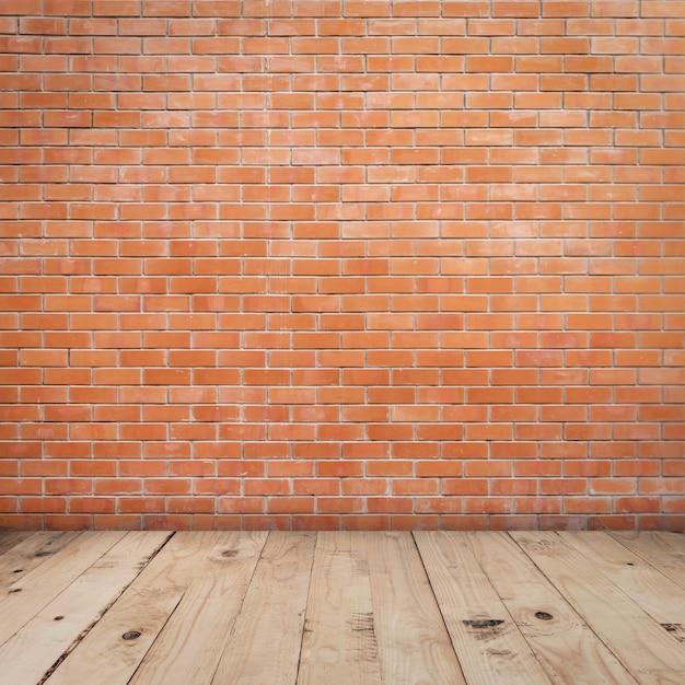 Oude rode bakstenen muur en houten vloer backgroung en textuur Premium Foto