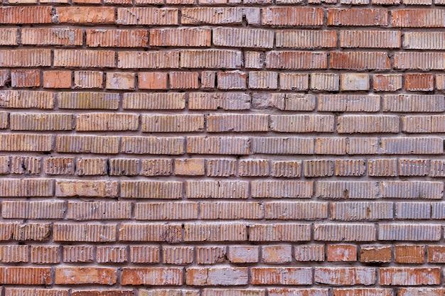 Oude rode bakstenen muur, rustieke textuur Premium Foto