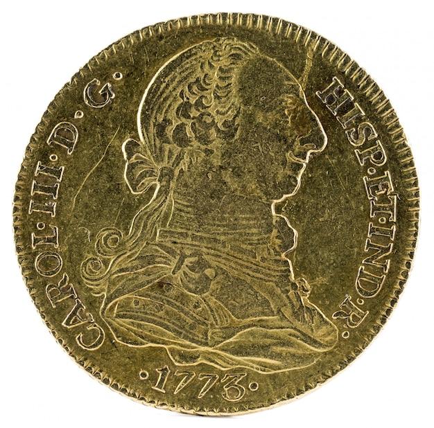 Oude spaanse gouden munt van koning carlos Premium Foto