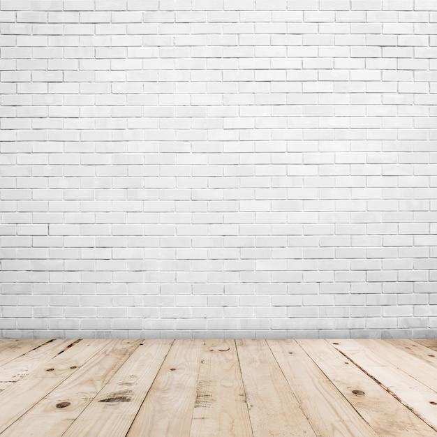Oude witte bakstenen muur en houten vloer backgroung en textuur met exemplaarruimte Premium Foto