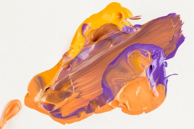 Paarse, gele en oranje verf gemengd Gratis Foto