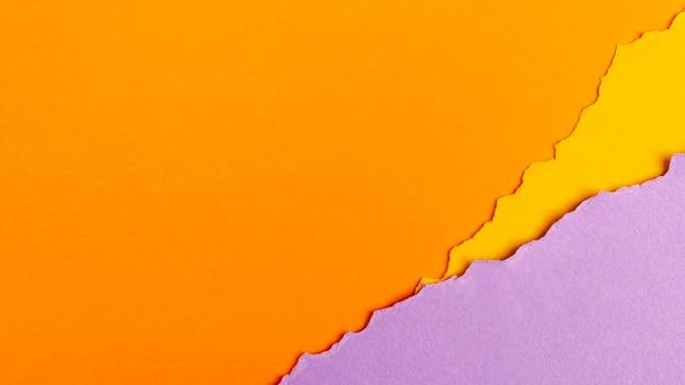 Pak kleurrijke vellen met kopie ruimte Gratis Foto