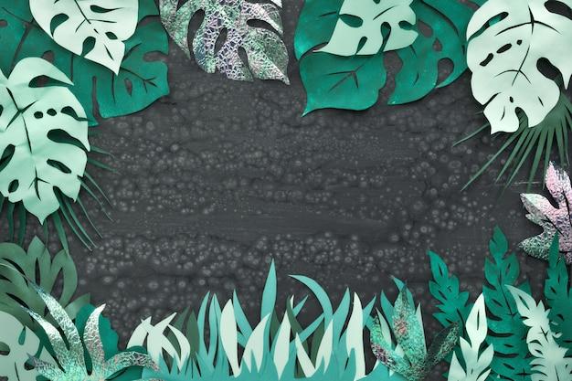 Papier ambachtelijke, frame met exotische tropische bladeren met tekstruimte op donker Premium Foto