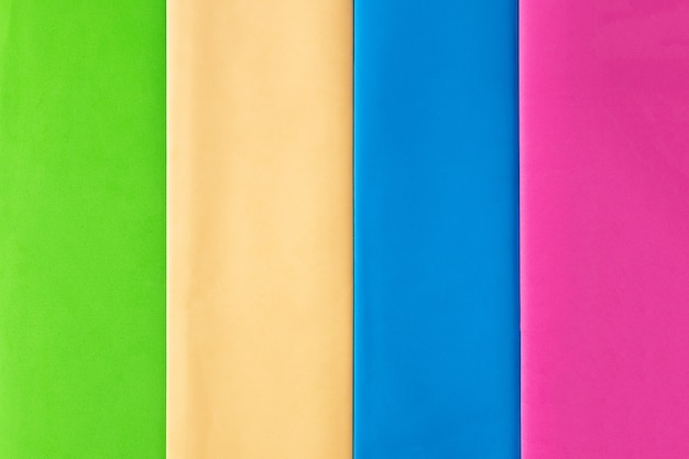 Pastelkleur creatieve kleurendocument achtergrond, mening van hierboven. Premium Foto
