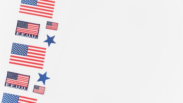 Patroon van de vs vlaggen op witte achtergrond Gratis Foto