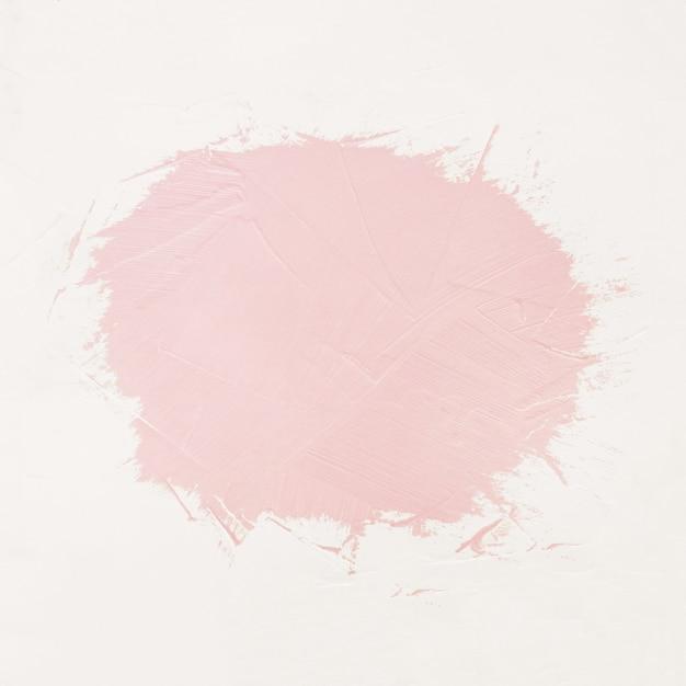 Penseelstreken van roze verf met ruimte voor uw eigen tekst Gratis Foto