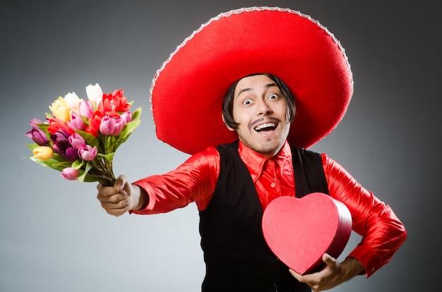 Persoon die sombrerohoed in grappig concept draagt Premium Foto