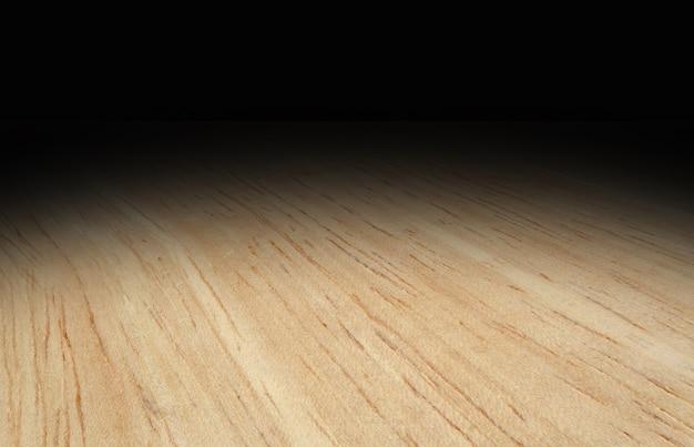 Perspectief lichte houten vloer vervagen tot zwarte achtergrond