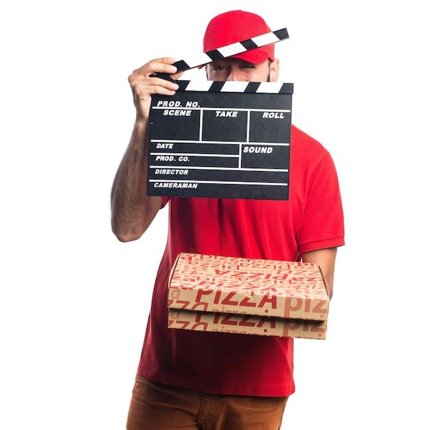 Pizza levering man met een klapperbord Gratis Foto
