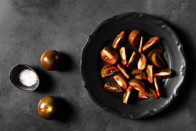 Plakjes tomaten en zout Gratis Foto