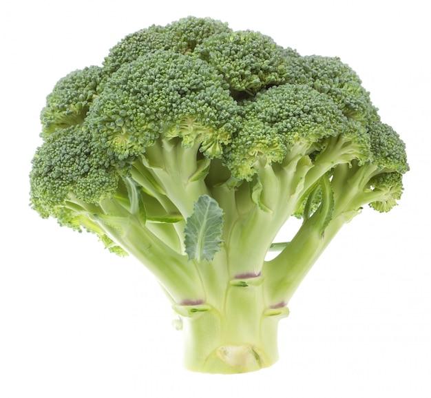 Plantaardige broccoli op een witte muur. detailopname. Premium Foto