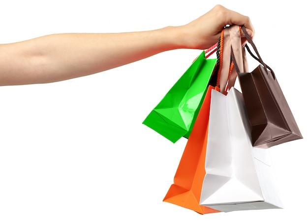 Plastic tas. vrouwelijke handholding het winkelen zak op wit Premium Foto