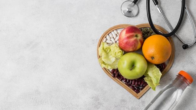 Plat leggen gezondheid stilleven met kopie ruimte Gratis Foto