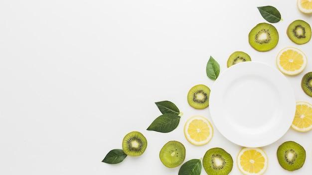 Plat leggen van fruit concept met kopie ruimte Gratis Foto