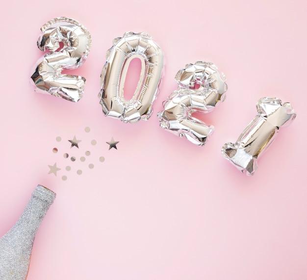 Plat leggen van prachtige nieuwe jaar concept Gratis Foto