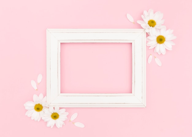 Plat leggen van wit frame met kopie ruimte Gratis Foto